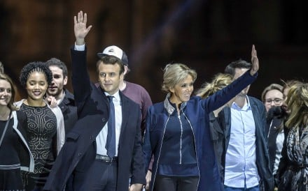 Emmanuel Macron and his wife Brigitte Trogneux celebrate his election victory. Photo: EPA