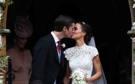 Pippa Middleton kisses her new husband James Matthews, following their wedding ceremony at St Mark's Church in Englefield, west of London, on May 20, 2017. Photo: REUTERS