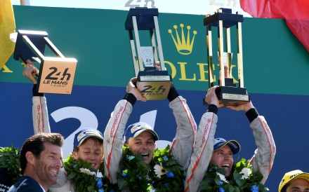 New Zealand's driver Brendon Hartley, New Zealand's driver Earl Bamber and Germany's driver Timo Bernhard celebrate on the podium after winning the 85th Le Mans 24-hours endurance race. Photo: AFP