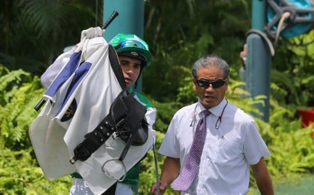 Joao Moreira and Tony Cruz discuss Pakistan Star's antics. Photos: Kenneth Chan