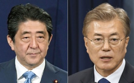 South Korean President Moon Jae-in (right) has made improved ties with Japan under Prime Minister Shinzo Abe a priority for his government, but obstacles remain to sustained reconciliation. Photo: Kyodo