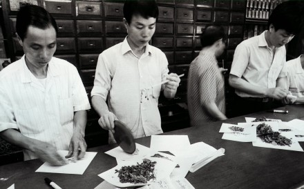 Staff at Eu Yan Sang's Chinese medicine shop in Central dispensing Chinese herbs in the 1980s. The company now has 248 retail outlets and 34 clinics in Asia and further afield. Photo: SCMP