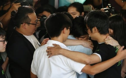 Joshua Wong, Nathan Law, Alex Chow and Lester Shum embrace outside the High Court. Photo: Sam Tsang