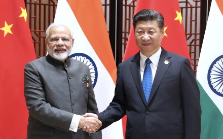 Indian Prime Minister Narendra Modi (left) and Chinese President Xi Jinping agreed to work together to ensure peace when they met on the sidelines of the BRICS summit in Xiamen on Tuesday. Photo: Xinhua