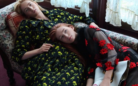 Olivia (left) wears black jacket with embroidered yellow flowers (US$2,560) and matching skirt (US$1,702), both by Simone Rocha from I.T. Sarah wears sheer dress with red embroidered flowers by Simone Rocha from I.T (inquiries: 2890 7012). Hat (US$666) by Loewe. Photography: Olivia Tsang
