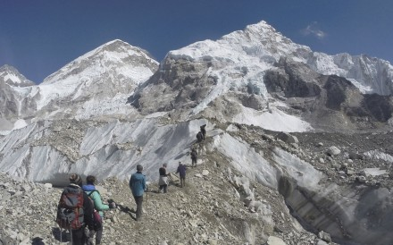 International trekkers pass through a glacier at the Mount Everest base camp, Nepal. Scientists say a third of the ice stored in Asia's glaciers will be lost by the end of the century even if global warming stays below 1.5 degrees Celsius. Photo: AP