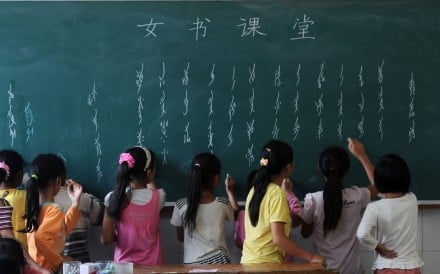 Elementary school students practise writing the Nushu script in Hunan province. Picture: Xinhua