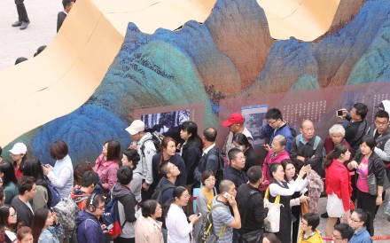 "Visitors line up to see ""A Panorama of Rivers and Mountains: Blue-Green Landscape Paintings from Across Chinese History"" at the Palace Museum in Beijing. Photo: Simon Song"