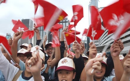 Pupils waving flags at a National Day ceremony at Golden Bauhinia Square in Wan Chai on October 1. Photo: Sam Tsang