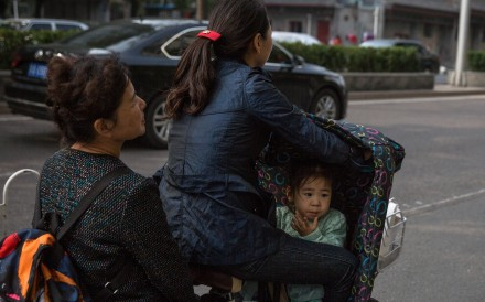 Chinese women are putting in more hours at the workplace and shouldering a bigger burden in the home than men, according to an international study. Photo: EPA