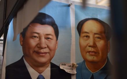 Portraits of Chinese President Xi Jinping (L) and late communist leader Mao Zedong at a market in Beijing. Xi's decision not to elevate a designated successor at the party's latest congress breaks with a 25-year tradition. Photo: AFP
