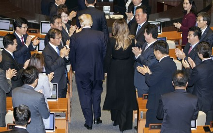 South Korean legislators applaud US President Donald Trump and First Lady Melania Trump at the National Assembly in Seoul on Wednesday. In a speech before the assembly, the first by a US president in nearly a quarter-century, Trump could hardly contain his praise for the close US ally. Photo: Pool via Bloomberg