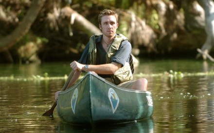 Philippe Cousteau, grandson of the famous marine explorer Jacques Cousteau, paddles in the waters of Blue Spring State Park in Florida, August 8, 2006. Cousteau is working on a documentary about Blue Spring and its famous manatees for National Public Radio. (Dennis Wall/Orlando Sentinel/MCT)