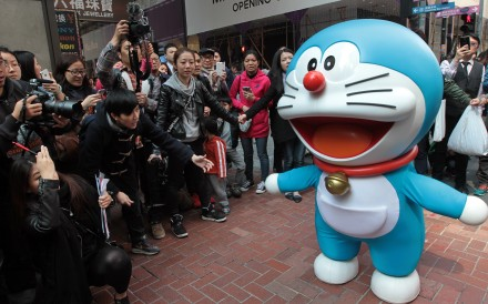 Japanese manga series character Doraemon makes an appearance in the Hong Kong shopping district of Causeway Bay. Photo: Bruce Yan