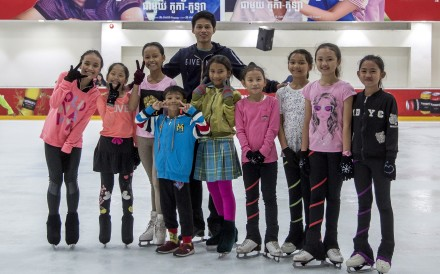 Sen Bunthoeurn, who competed at the Southeast Asian Games, with some of the young skaters he coaches in Phnom Penh.