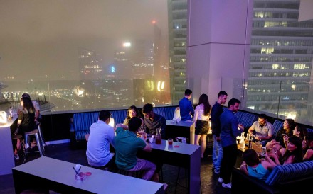 Guests enjoy drinks at the Skyline bar overlooking Singapore's financial district. Photo: AFP