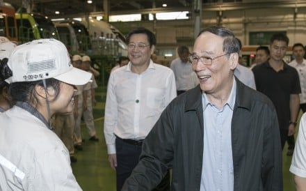 In his first public appearance after the annual Beidaihe conclave, Wang Qishan visits CRRC Zhuzhou Locomotive in Hunan in September while still the anticorruption tsar. Photo: Xinhua