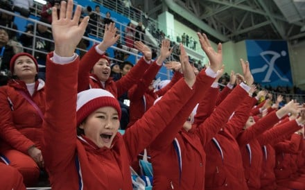 North Korean cheerleaders perform during the women's preliminary round ice hockey match between the unified Korea team and Switzerland at the Pyeongchang 2018 Winter Olympics. Photo: AFP