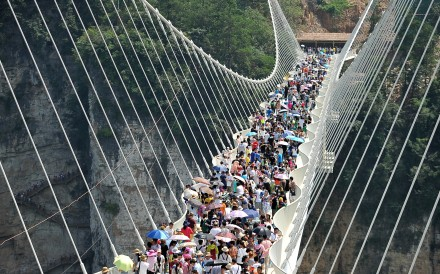 Entry to Zhangjiajie, and its famous glass bridge, costs the equivalent of US$95. Photo: Reuters