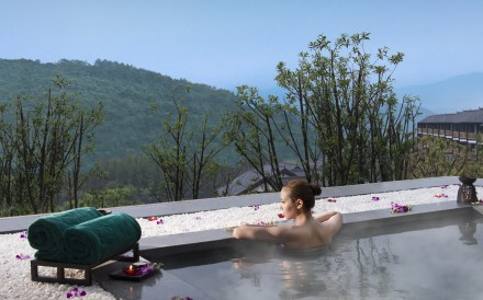 A guest relaxes in a private hot springs pool at Banyan Tree Chongqing Beibei, located in the hills near Chongqing city about a 50-minute car ride from the city's airport.