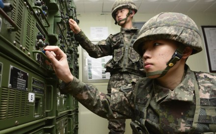 South Korean soldiers adjust equipment used for propaganda broadcasts near the border area between South Korea and North Korea. Photo: AP