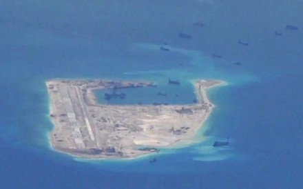 US intelligence assessments reportedly indicated Chinese missiles were moved to Fiery Cross Reef (pictured), Subi Reef and Mischief Reef within the past 30 days. Photo: US Navy via Reuters