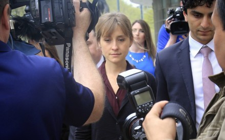 Actress Allison Mack leaves Brooklyn Federal Court after a hearing on Friday May 4, 2018. Photo: AP