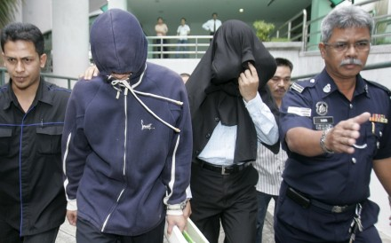 Policemen Azilah Hadri and Sirul Azhar Umar arrive at court in Shah Alam outside Kuala Lumpur in January, 2009. Photo: Reuters