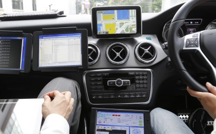 A car monitor shows a 3D digital map as it's driven through Tokyo streets. Technology companies are racing to develop ultra-precise three-dimensional digital maps that can guide self-driving cars to within inches of where they are supposed to be. Photo: AP