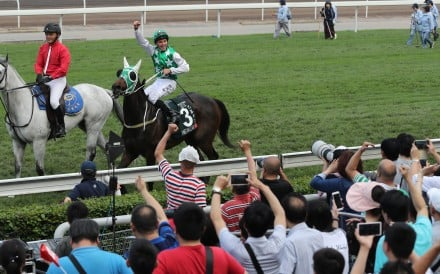 William Buick celebrates Pakistan Star's QE II Cup win with the fans. Photos: Kenneth Chan