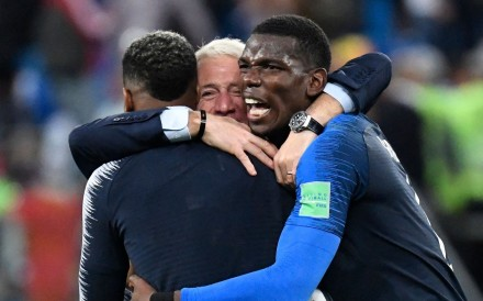 France manager Didier Deschamps (centre) celebrates France's win with Paul Pogba (right) and Presnel Kimpembe at the end of the World Cup semi-final win over Belgium. Photo: AFP