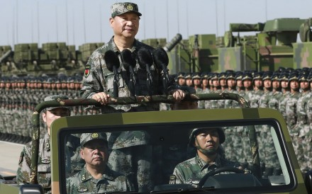 Xi Jinping inspects troops during last year's parade marking the 90th anniversary of the PLA's founding. Last week, Xi warned that the military should be on high alert. Photo: Xinhua via AP