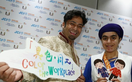Actor and event ambassador Ricky Chan (left) with emcee Arashdeep Kaur at the release of the results of a survey on the employment of ethnic minorities, conducted by youth NGO Junior Chamber International (Harbour), in Central on July 29. Photo: Nora Tam