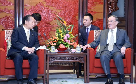 Chinese Vice-President Wang Qishan (right) meets Toshihiro Nikai secretary general of Japan's ruling Liberal Democratic Party, in Beijing on Friday. Photo: Xinhua