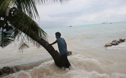 Low-lying island Pacific countries including Kiribati are forecast to be among the first on the plant to disappear underwater if rising sea levels are not arrested. Photo: Alamy