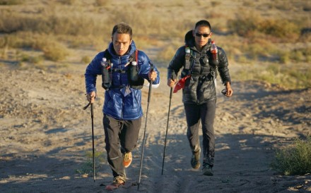 Liang Jing (left) and Zhou Jiaju battle it out at the Ultra Gobi 400km race. Photo: Lloyd Belcher Visuals