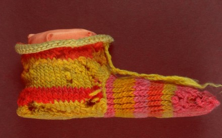 The sock belonged to a child in Roman-era ancient Egypt and showed clever use of dyes. Photo: courtesy British Museum