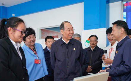 You Quan, Centre, head of the ruling Communist Party's United Front Work Department, which oversees ethnic and religious affairs, visiting the Ningxia Institute of Science and Technology in Shizuishan City last month. Photo: Xinhua