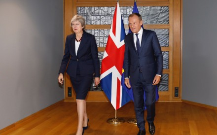European Council President Donald Tusk (right) meets with British Prime Minister Theresa May prior to an EU summit in Brussels on Wednesday. Photo: Xinhua
