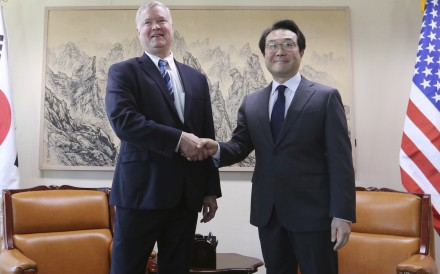 US Special Representative for North Korea Stephen Biegun shakes hands with South Korea's Special Representative for Korean Peninsula Peace and Security Affairs Lee Do-hoon during a meeting in Seoul, South Korea, on Monday. Photo: AP