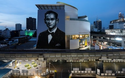 A portrait of the late King Bhumibol Adulyadej adorns the Bangkok Art and Culture Centre. Picture: Reuters