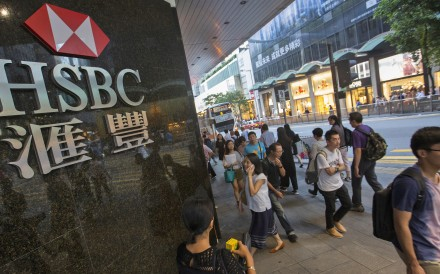 "People walk past the HSBC logo in Central District on October 29. HSBC posted strong third-quarter profits, despite a leaked memo, revealed in September, from investment bankers that criticised the company's ""utterly failed"" investment banking strategy. Photo: EPA-EFE"
