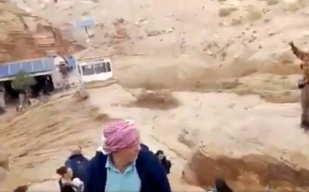 Floodwaters rage through the ancient city of Petra in Jordan on Friday. Photo: Twitter / @AKalefah