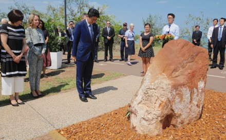 Japanese Prime Minister Shinzo Abe visiting a memorial to the Imperial Japanese Navy's I-124 submarine, which sank in 1942 off the Northern Territory city of Darwin, Australia on November 17, 2018. Photo: Reuters