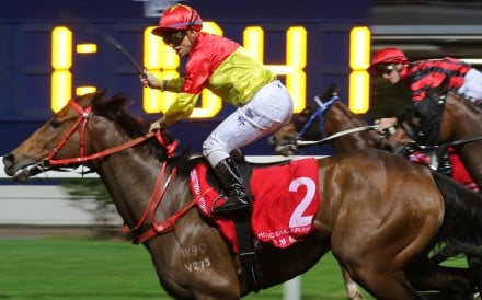 Umberto Rispoli salutes as Starlight takes out the last race at Happy Valley on Wednesday night. Photos: Kenneth Chan