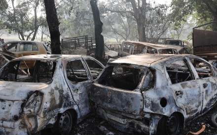Cars were set ablaze in the mob attack on a police station. Photo: AP