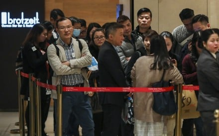 Buyers queue outside Sino Land's sales centre at Empire Centre in Tsim Sha Tsui. The company on Tuesday had put 383 flats on sale at its Grand Central project in Kwun Tong. Photo: Nora Tam