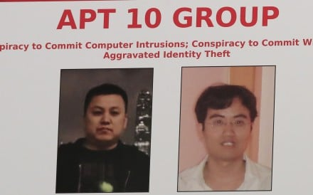 A poster displayed during a news conference at the Department of Justice in Washington, showing two Chinese citizens suspected to be with the group APT 10. Japan criticised China for cyberattacks. Photo: AP