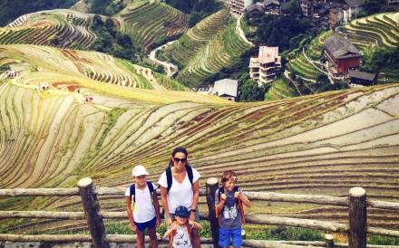 Cecile Pont and her children in Rice fields in Guilin, China.