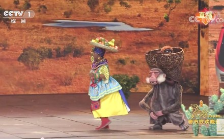 A Chinese actress in blackface does an exaggerated impression of an African woman, alongside her sidekick, a monkey, in Chinese state broadcaster CCTV's Spring Festival Gala in February 2018. The depiction sparked a global debate on China's attitudes to racism. Image: CCTV via YouTube